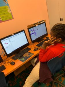 Students participating in code your world.
