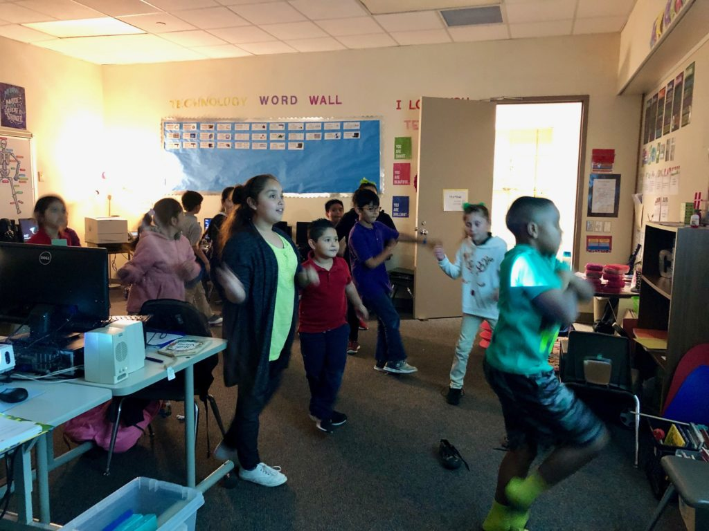 The students at Hearne Elementary School dancing while using their fitness trackers.